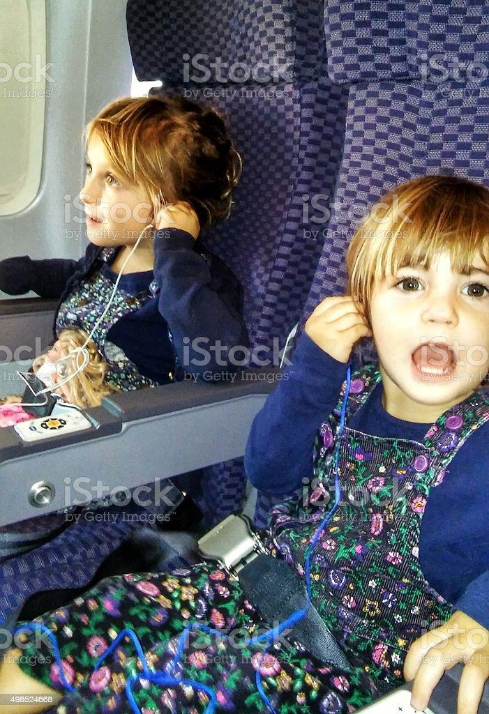 Kids on a plane stock photo