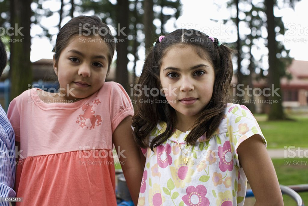 kids on carousal in playground royalty free stockfoto