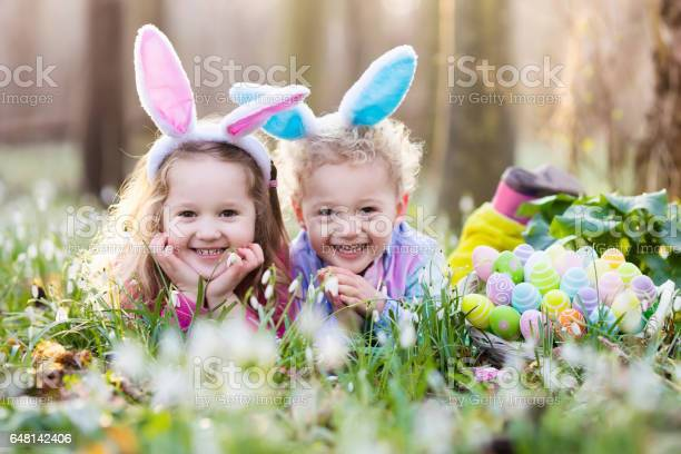 Kids on easter egg hunt in blooming spring garden picture id648142406?b=1&k=6&m=648142406&s=612x612&h=9elksz6u5muu2tshlqm l tloq 62ofutnl6v3kd1tm=