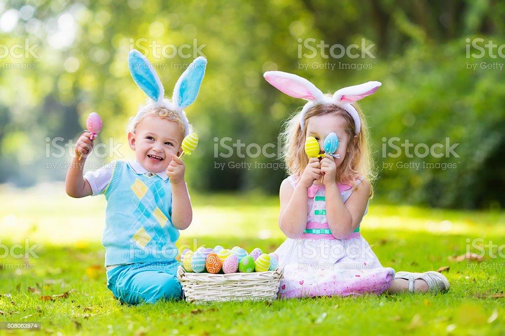 Kids on Easter egg hunt stock photo