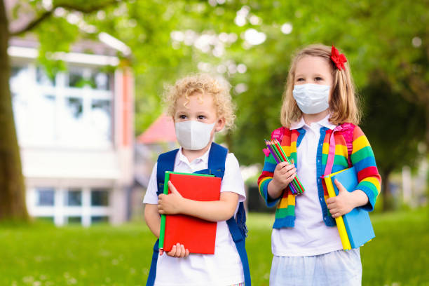 Kids on first school day after quarantine. stock photo