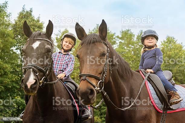 Kids on horses brother and sister horseback riding picture id492100426?b=1&k=6&m=492100426&s=612x612&h=udh7yx6k8xjr5uz5p8ko0q6okgsj35kznawmkegs1ks=