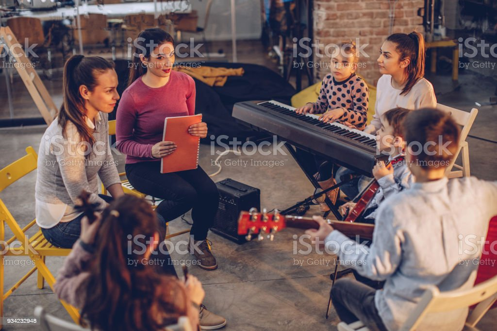 Kids on music school class stock photo