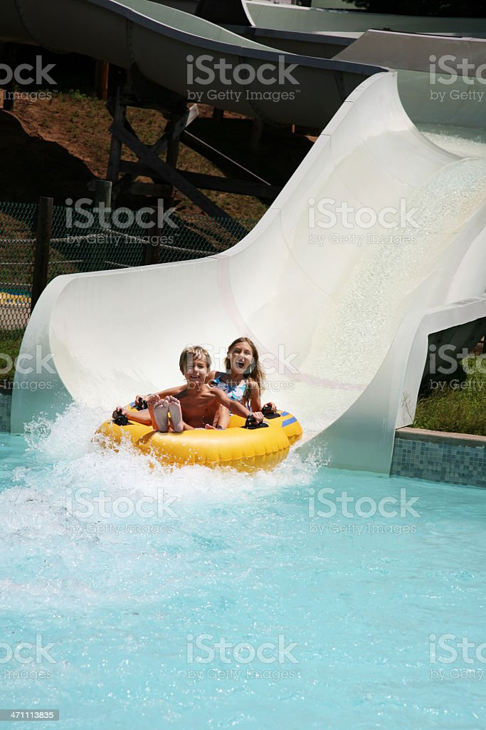 Kids on Water Slide at  Waterpark playground royalty-free stock photo