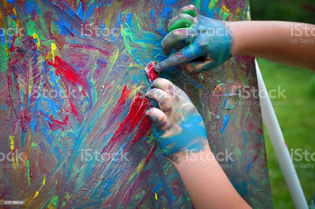 Kids paint with hands on canvas stock photo