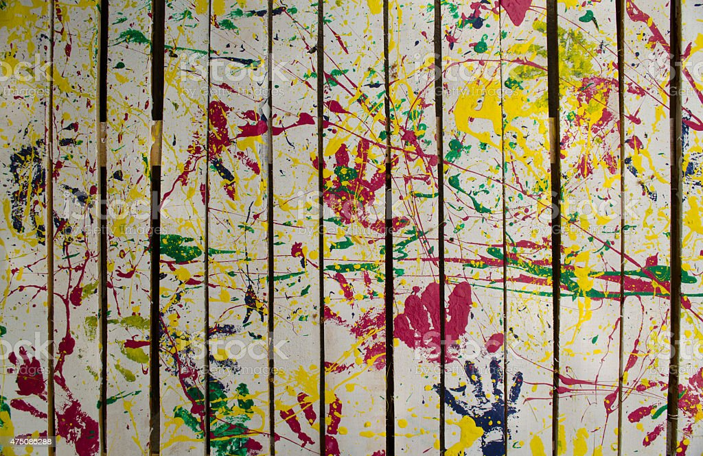 kids painted fence stock photo