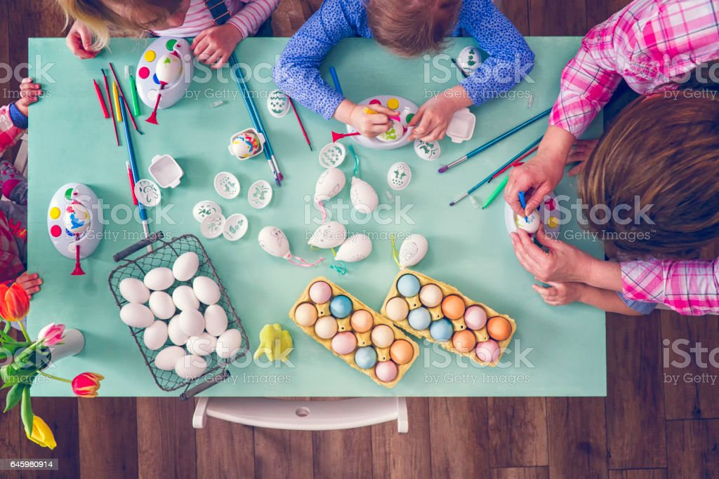 Kids Painting Easter Eggs stock photo
