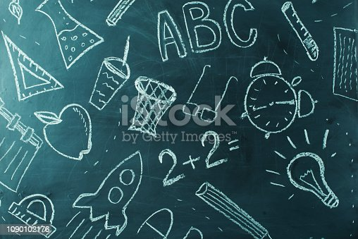 istock Kids painting on school chalkboard, background 1090102176