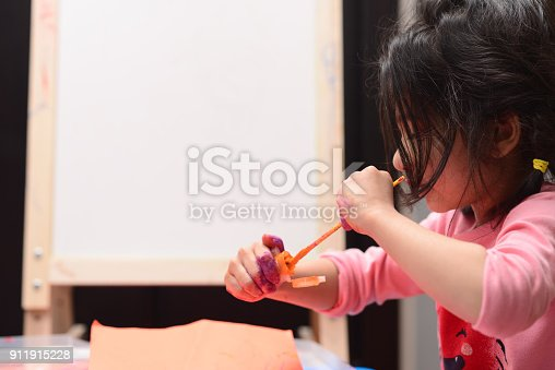 154371635 istock photo Kids painting 911915228