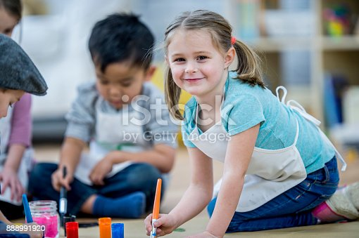 istock Kids Painting Together 888991920