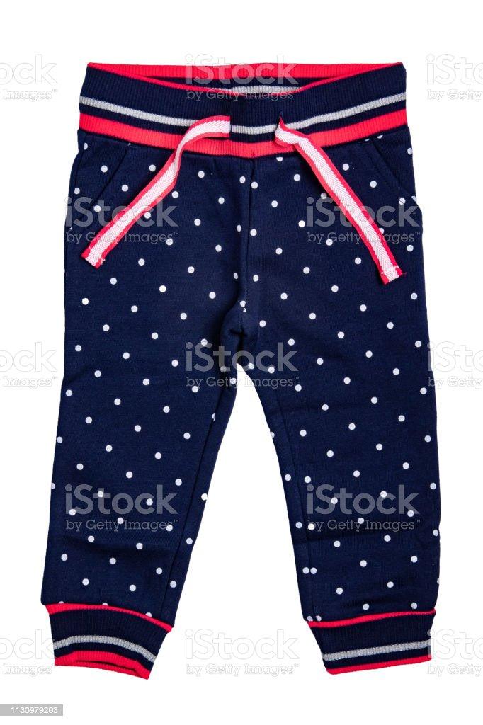 Pantalones De Ninos Aislados Un Elegante Pantalon Denim De Moda Azul Oscuro Con Puntos Blancos Para La Nina Pantalones Deportivos Para Ninos Foto De Stock Y Mas Banco De Imagenes De A