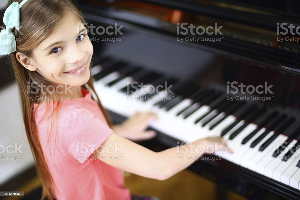 Kids piano lesson. royalty-free stock photo