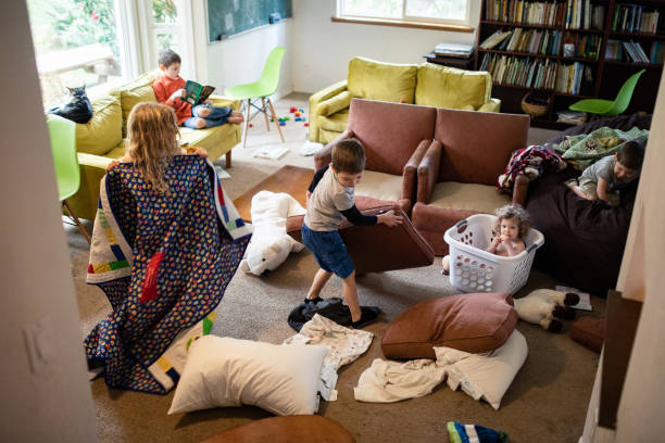 Kids Play and Imagine In Messy Living Room
