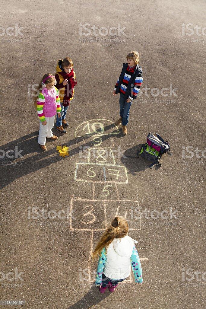 Kids play hopscotch stock photo