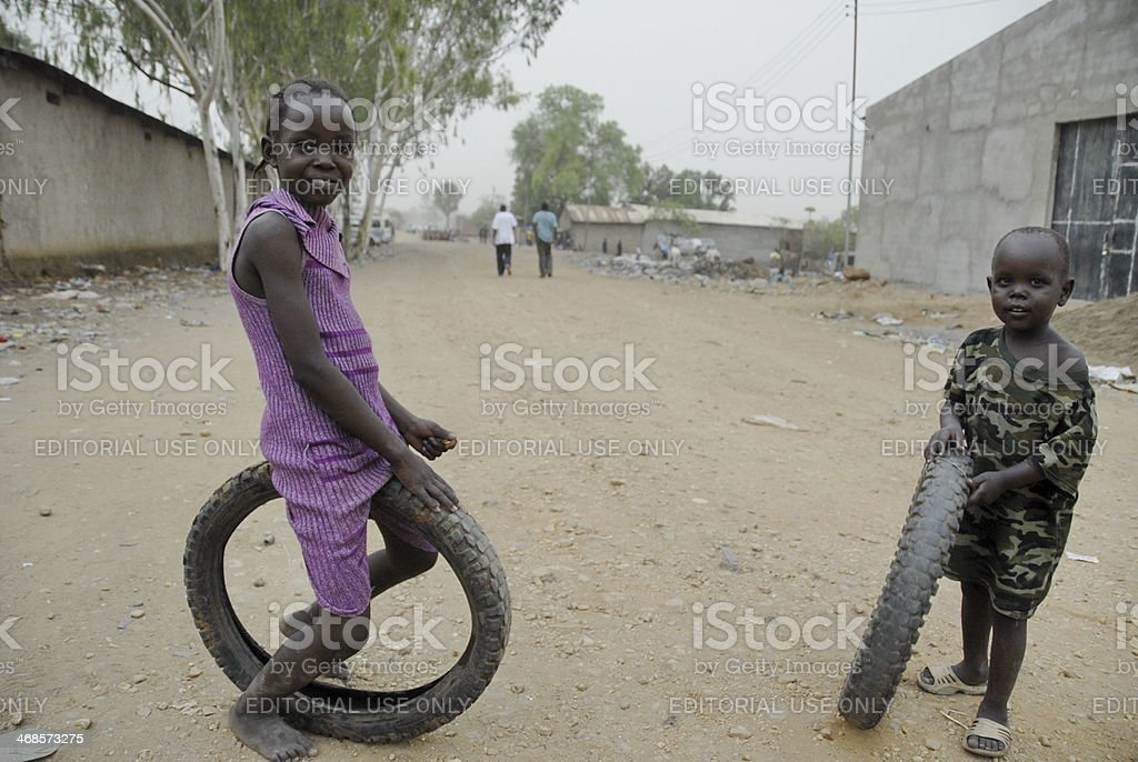 Kids play on a street in Juba, South Sudan. stock photo