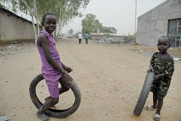 kids play on a street in juba, south sudan. - disinherit stock pictures, royalty-free photos & images