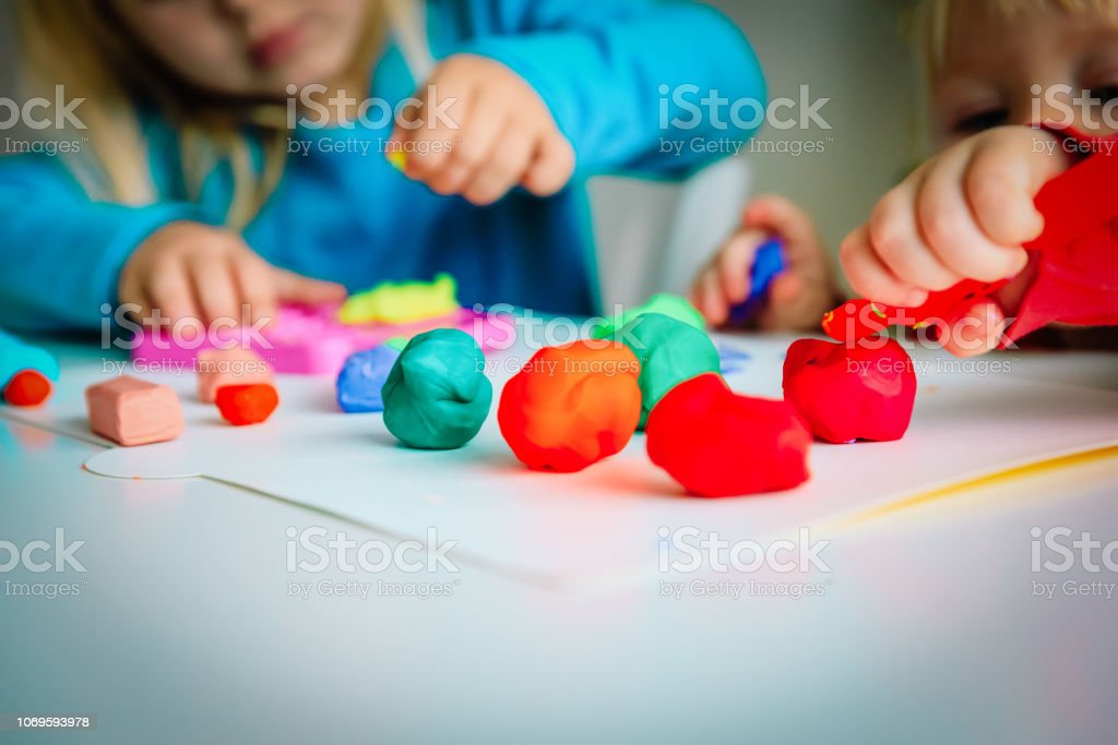 kids play with clay molding shapes, learning through play kids play with clay molding shapes, learning through play concept Art Stock Photo