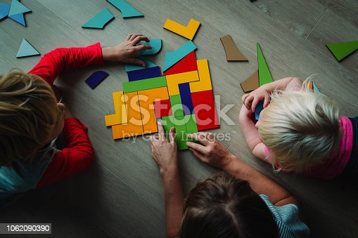 kids play with puzzle, learn math, education concept