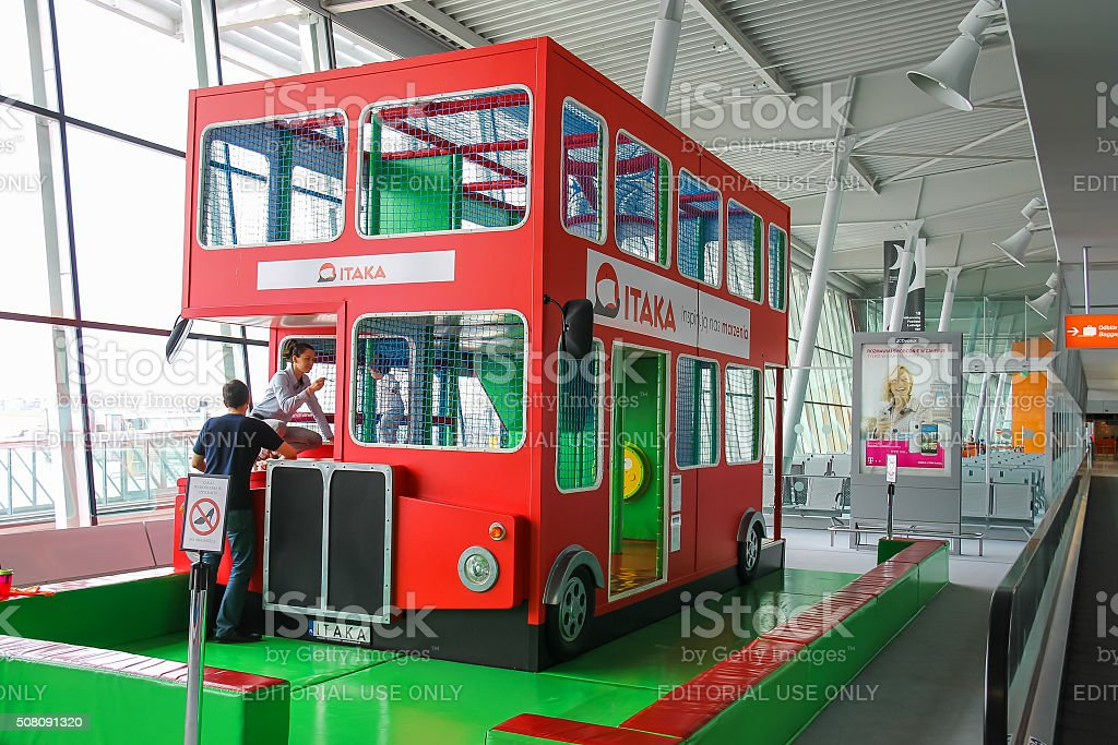 Kids playground-bus in Warsaw Chopin Airport, Poland stock photo