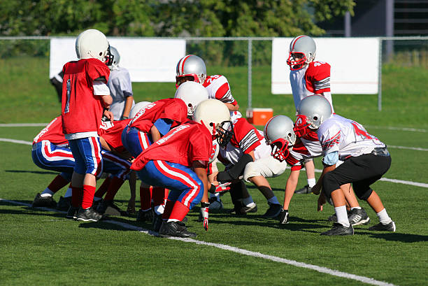 Kinder beim american football – Foto