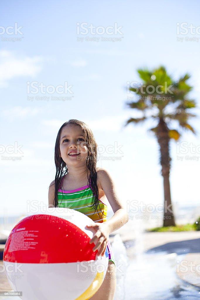 Kids playing around pool royalty-free stock photo
