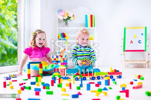 istock Kids playing at day care with wooden toys 476541680