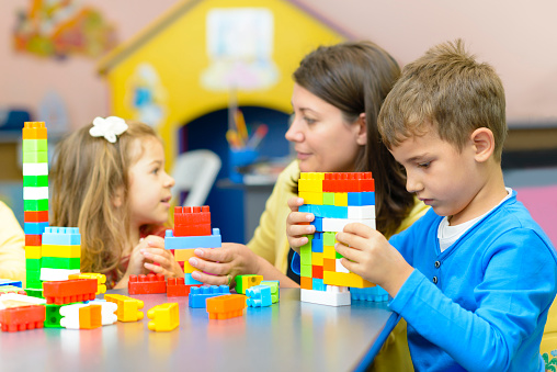 Kids Playing At Kindergarten Stock Photo - Download Image Now