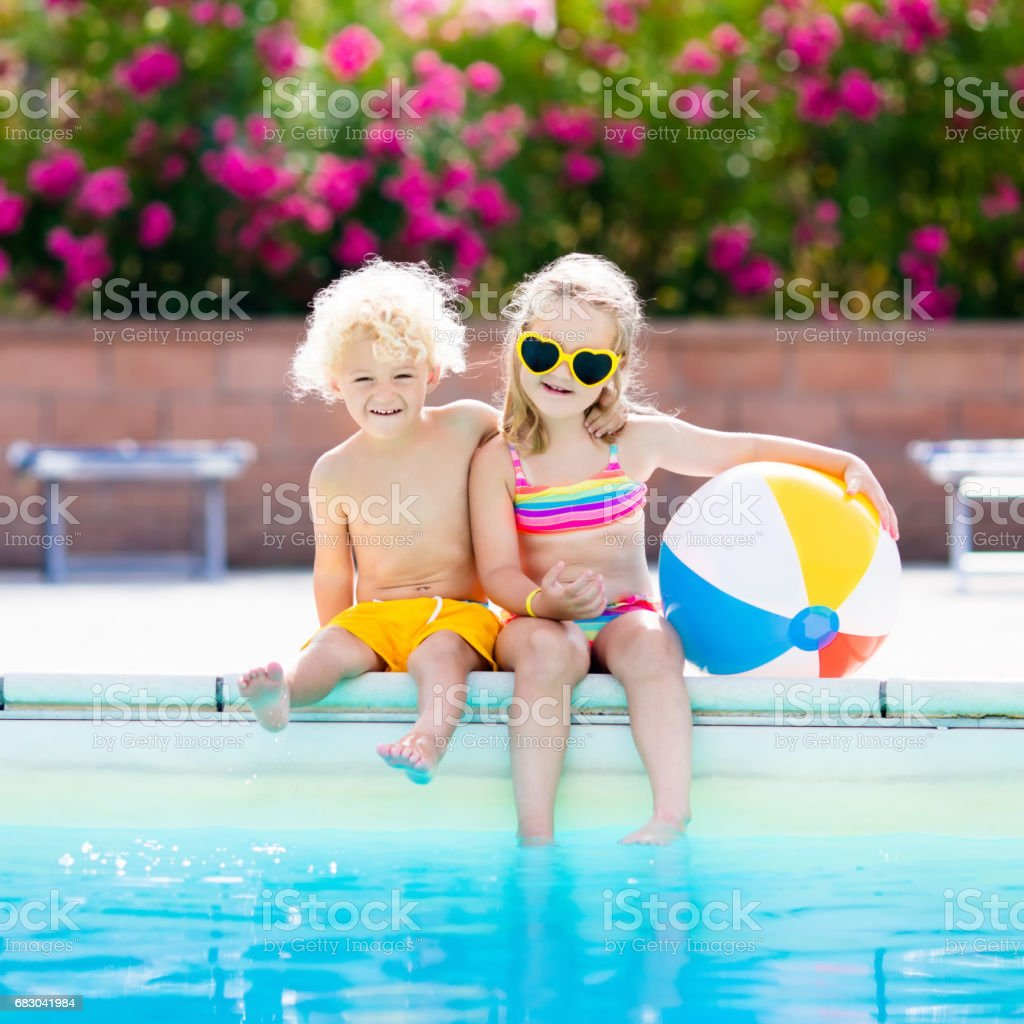 Kids playing at outdoor swimming pool royalty-free stock photo