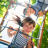 istock Kids playing at the playground 584757160