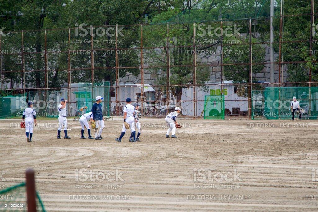 Unidentified kids playing baseball in Osaka, Japan. Baseball was...