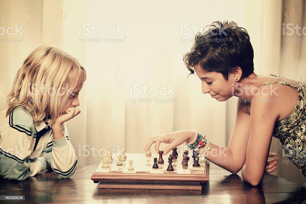 Kids playing chess royalty-free stock photo