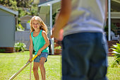 istock kids playing cricket 498377992