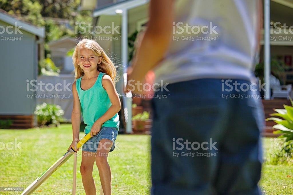 kids playing cricket stock photo