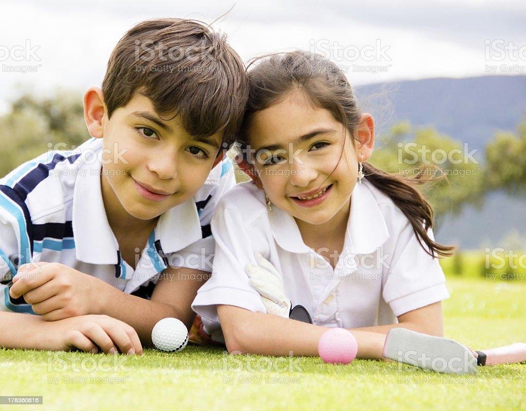 Kids playing golf royalty-free stock photo