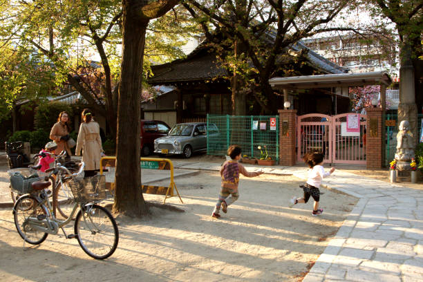 Kids Playing in front of a Kindergarten Gate