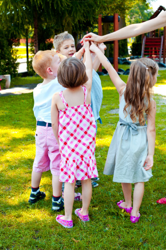 Kids Playing In Garden Stock Photo - Download Image Now