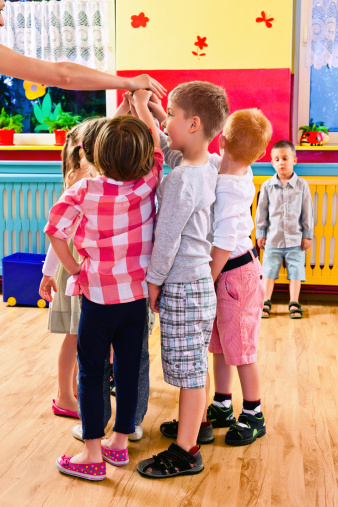 Kids Playing In Playroom Stock Photo - Download Image Now