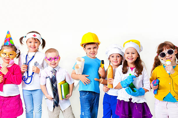 Kids playing in professions Group of seven children dressing up as professions dressing up stock pictures, royalty-free photos & images