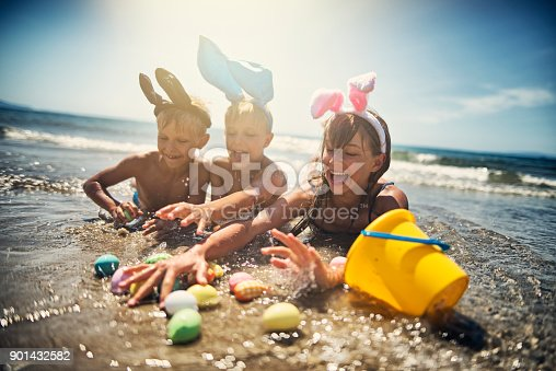 istock Kids playing in sea during summer Easter 901432582