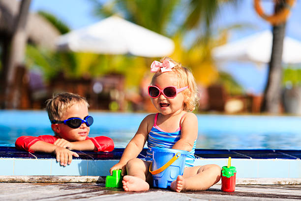 kids playing in swimming pool at the beach stock photo