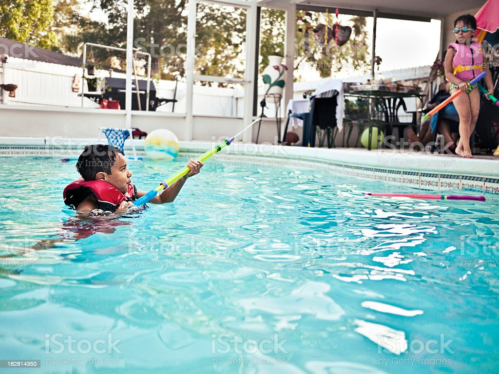 kids playing in the pool royalty-free stock photo