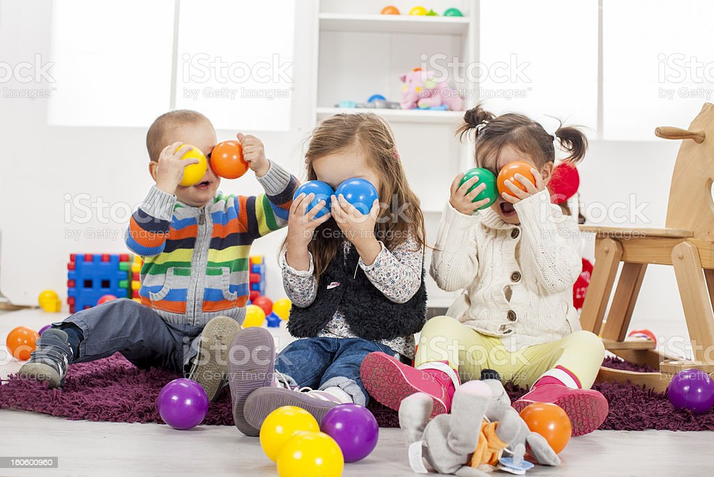 Kids playing in the room royalty-free stock photo