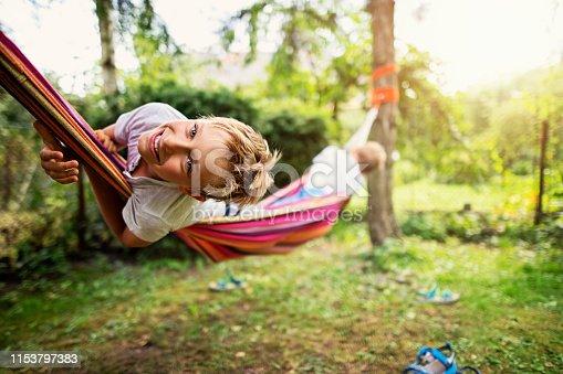 Little boys aged 8 are having fun on hammock. Nikon D850