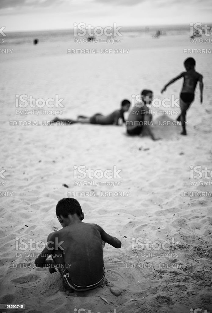 Kids playing on the beach in Ipanema royalty-free stock photo