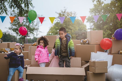 istock Kids playing outside in the cardboard boxes, 626914220