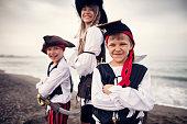 Kids playing pirates on a beach