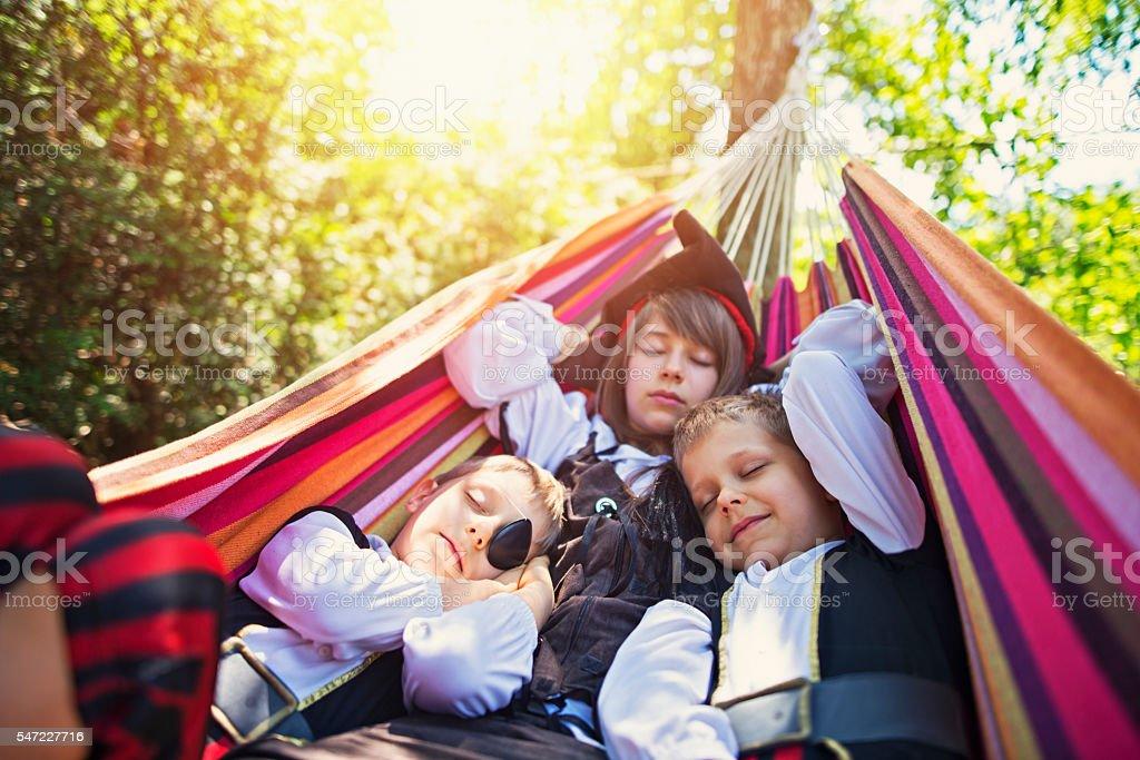 Kids playing pirates sleeping on hammock stock photo