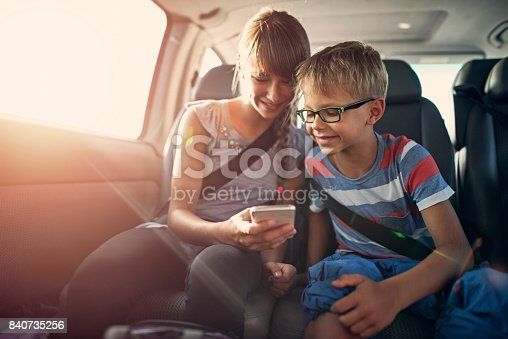 istock Kids playing smartphone during a road trip 840735256