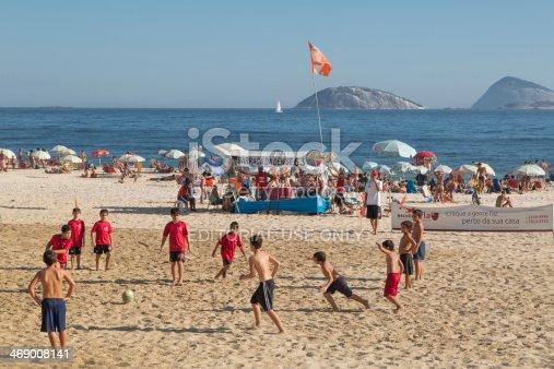 917307226 istock photo Kids playing soccer in Ipanema Beach 469008141