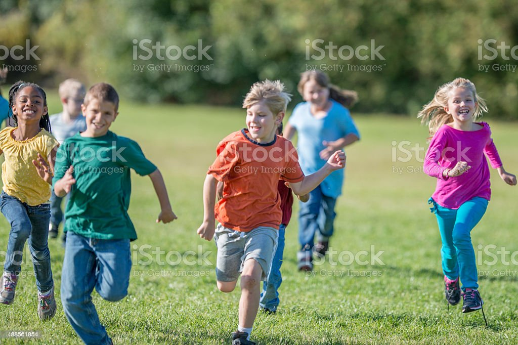 Kids Playing Tag at Recess stock photo